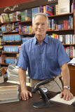 Male bookshop proprietor. Smiling at camera Stock Photography
