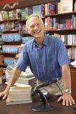 Male bookshop proprietor. Looking happy Stock Photos