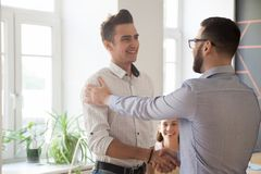Male boss handshaking intern greeting with job promotion stock photos