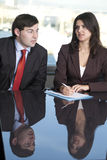 Male boss with his secretary Royalty Free Stock Photos