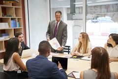 Male boss holding document at a business boardroom meeting stock photos