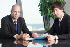 Male Boss signing documents Royalty Free Stock Photos
