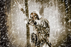 A male bow hunter in a forest Royalty Free Stock Photo