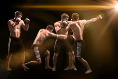 Male boxer boxing in punching bag with dramatic edgy lighting in a dark studio Stock Photos