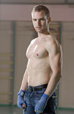 Male boxer in gym. Portrait of male boxer in gym Royalty Free Stock Photos