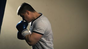 Male boxer at the gym hitting the punching ball. Closeup stock footage
