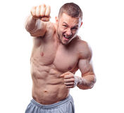 Male boxer making training punches on grey Royalty Free Stock Image