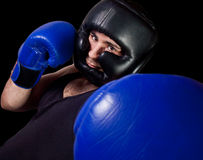 Male boxer punching Royalty Free Stock Images