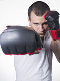 Male boxer punching Stock Photo