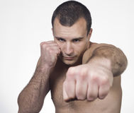 Male boxer punching Stock Images