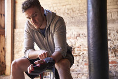 Male Boxer Putting On Gloves In Gym stock photos