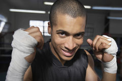 Male Boxer Smiling. Closeup portrait of male boxer smiling Royalty Free Stock Images