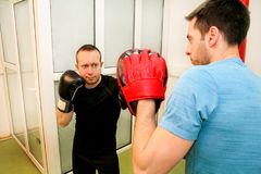 The male boxer training at gym Royalty Free Stock Photo