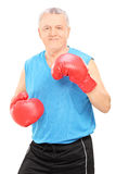 Male boxing coach holding guard Stock Photo
