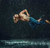 The male break dancer in water. Royalty Free Stock Images
