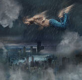 The male break dancer in water. The fantasy image of male break dancer in water on dark sky background Flying over the city at night Royalty Free Stock Photos