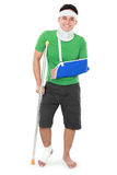 Male with broken arm and crutch Stock Photos