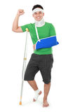 Male with broken arm and crutch Stock Photography