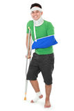Male with broken arm and crutch Royalty Free Stock Photos