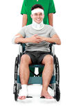 Male with broken arm and foot using wheel chair Royalty Free Stock Photos