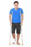 Male with broken foot using crutch royalty free stock photos