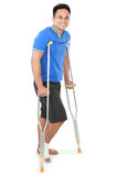 Male with broken foot using crutch Stock Images
