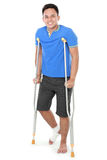 Male with broken leg using crutch Stock Photo
