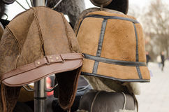 Male brown decorated winter hats on rack. Outdoor Royalty Free Stock Photo