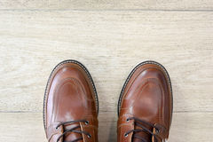 Male brown leather shoes on tile floor Royalty Free Stock Photos