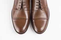 Male brown shoes leather. On white background, isolated Product Stock Photography