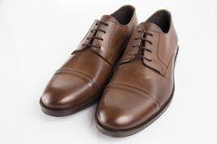 Male brown shoes leather. On white background, isolated Product Royalty Free Stock Images