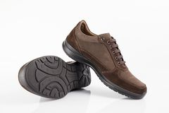 Male brown shoes leather. On white background, isolated Product Royalty Free Stock Image