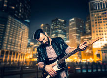 Male brutal performer with electric guitar Stock Photography