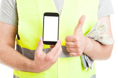Male builder doing thumbup and show smartphone Stock Photography