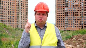 Male builder foreman, worker or architect on construction building site does not agree waving his finger.  stock video