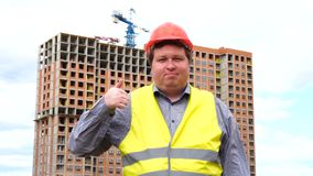 Male builder foreman, worker or architect on construction building site showing thumb up and looking to camera. Male builder foreman, worker or architect on stock video footage