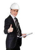 Male builder in hard hat with papers Stock Photos