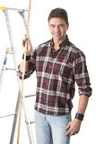 Male builder measuring with wooden rule Royalty Free Stock Image