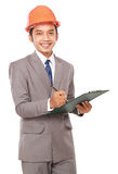 Male builder in orange headpiece with papers Stock Image