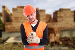 Male builder with pain on wrist Stock Image