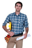 Male builder with plans Royalty Free Stock Photos