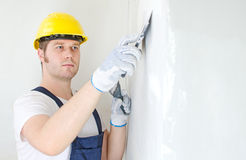 Male builder repairs wall Stock Photography