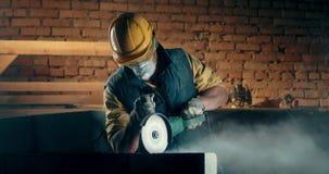 Male builder in respirator cutting wall