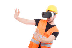 Male builder wearing futuristic vr glasses Royalty Free Stock Photo