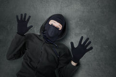 Male burglar expressing give up Royalty Free Stock Images