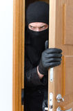 Male burglar in mask. Breaking into the house royalty free stock image