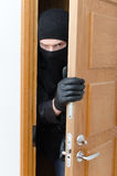 Male burglar in mask Stock Photo