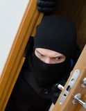 Male burglar in mask. Breaking into the house stock photography