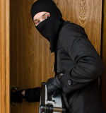 Male burglar stealing case. With money royalty free stock photo