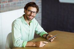 Male business executive holding digital tablet Royalty Free Stock Photo